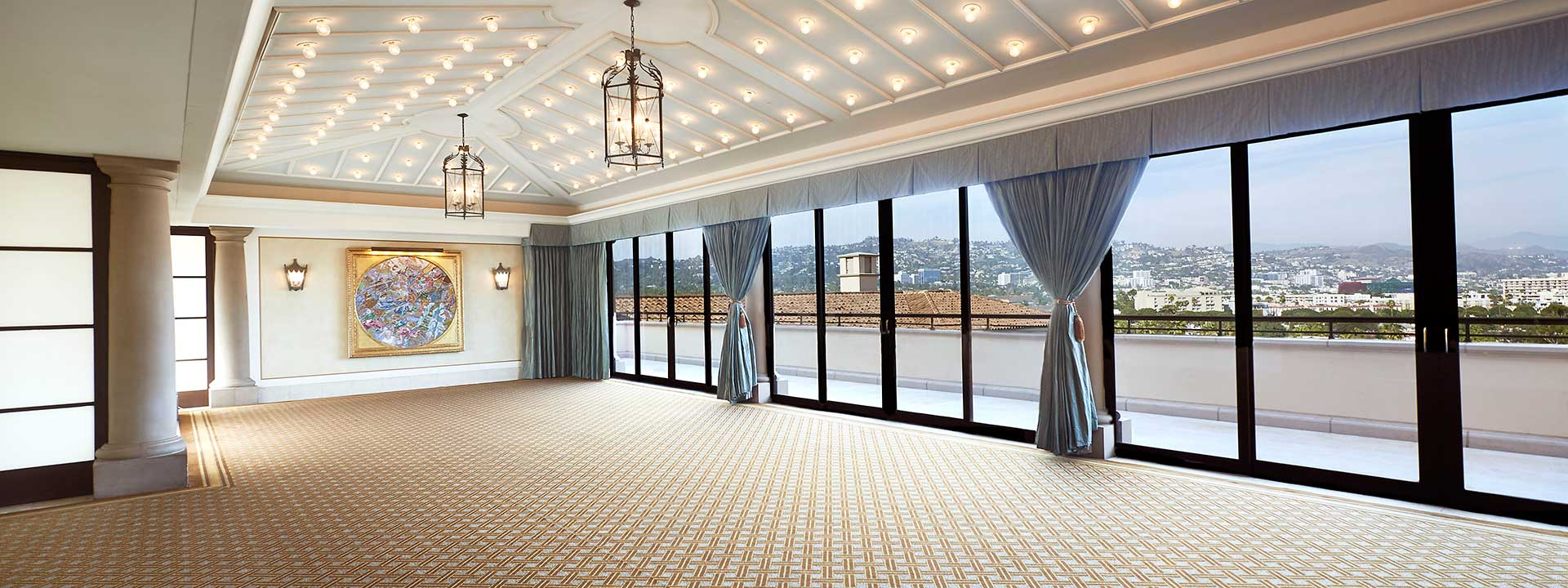 The Conservatory event space and view of the city through the glass panelled doors
