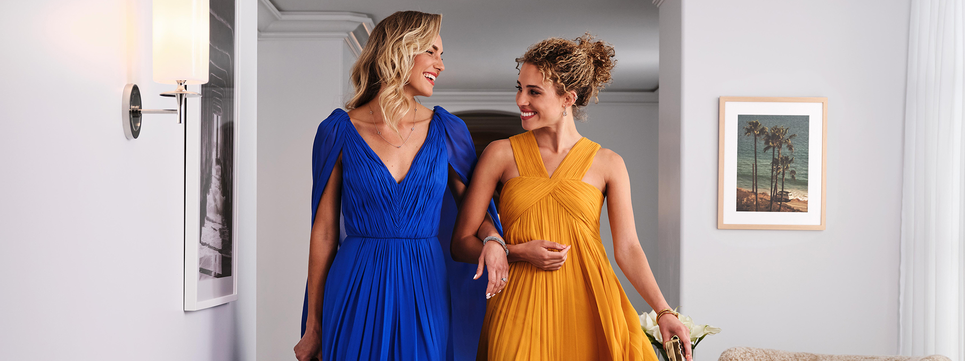 Two women fashionably dressed in the luxury suite