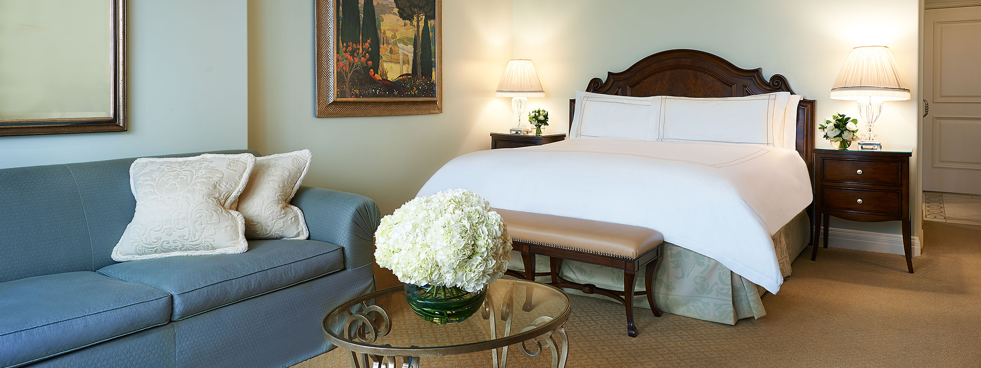 Premier King Room inward facing bedroom view