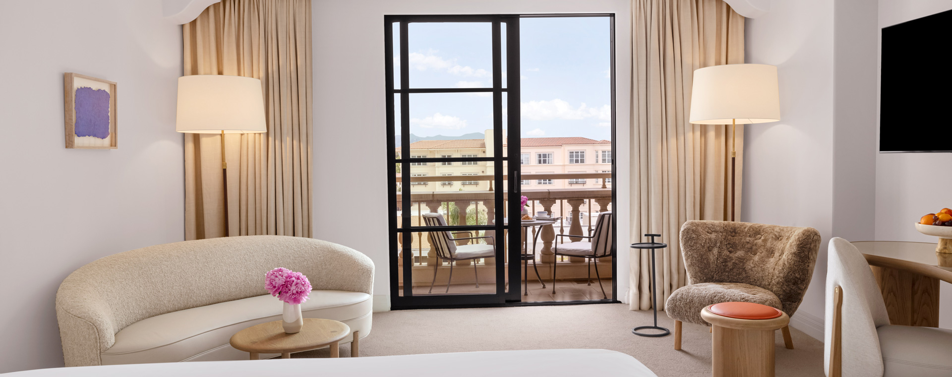 Terrace with two chairs and black pane windows in Maybourne Balcony Room